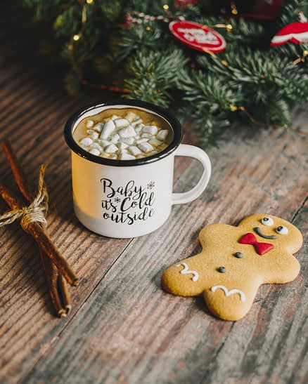 gingerbread man near hot chocolate